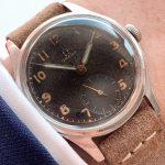 a2570 omega black dial patina (1)