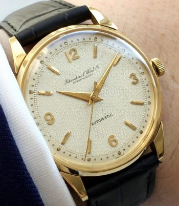 Investment Grade Solid Gold IWC with Textured Dial and Extract from the Archives