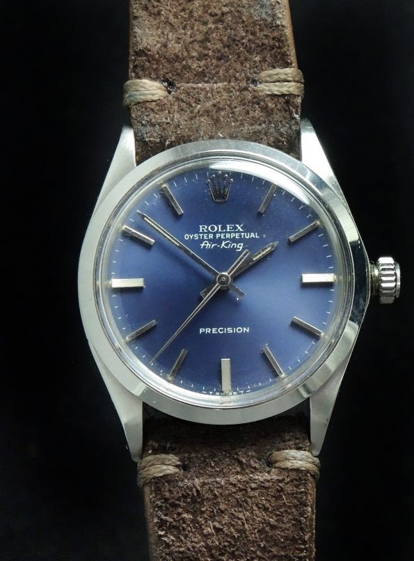 Top Rolex Air King with blue dial and Vintage Strap