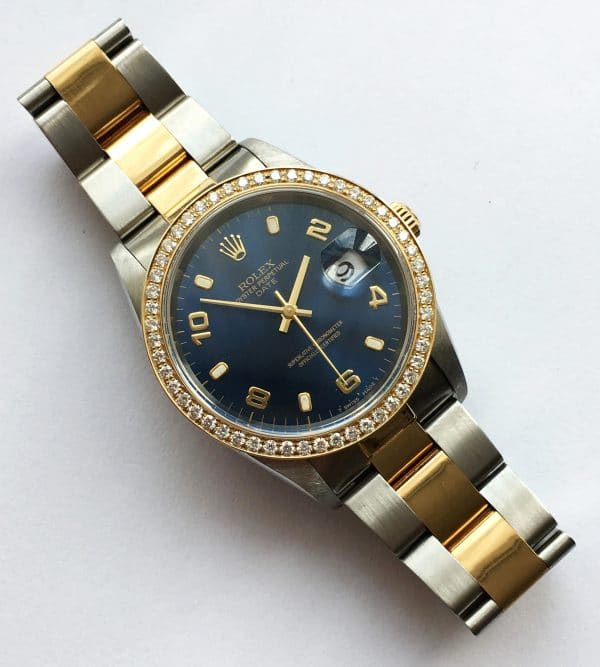 Rolex 34mm Date Automatic  Saphire Glas and Diamond Bezel