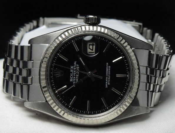 Serviced Rolex Datejust Automatik with black dial white gold bezel and Rolex Strap